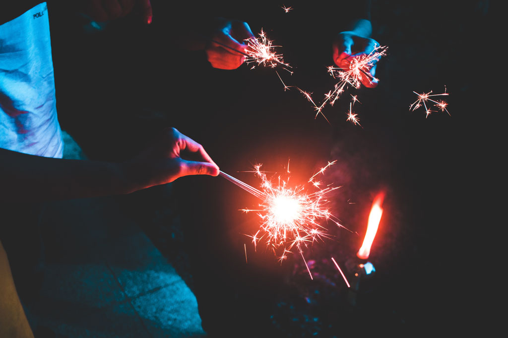 Group of people holding sparklers