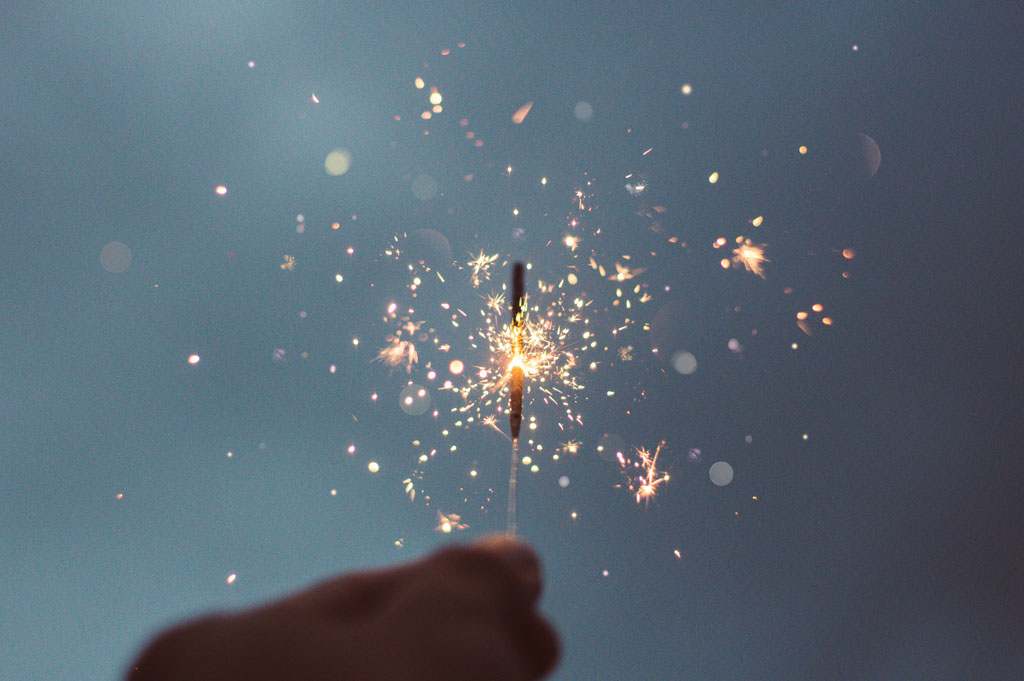 Individual hand holding a sparkler