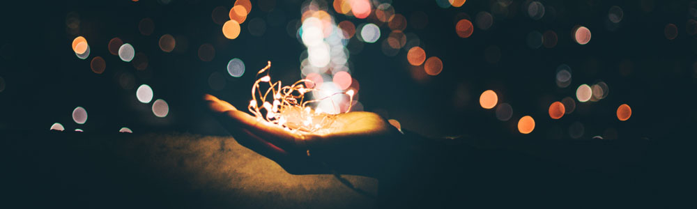 Image of hand holding string lights